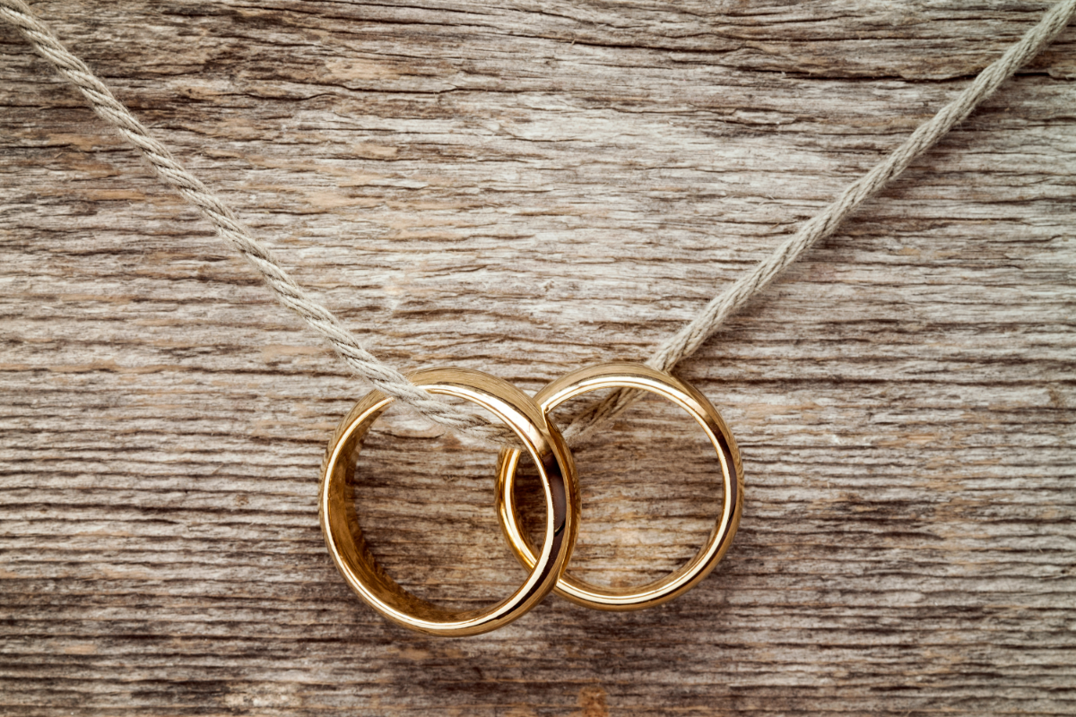 Two wedding rings on a rope